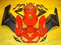 Honda CBR1000RR 2004 2005 red and black fairing kits, this Honda CBR1000RR 2004 2005 plastics was applied in red and blackgraphics, this 2004 2005 CBR1000RR fairing set comes with the both color and decals shown as the photo.If you want to do custom fairings for CBR1000RR 2004 2005,our talented airbrusher will custom it for you.