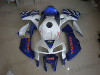 Honda CBR600RR 2005 2006 white and blue fairing kits, this Honda CBR600RR 2005 2006 plastics was applied in white and blue graphics, this 2005 2006 CBR600RR fairing set comes with the both color and decals shown as the photo.If you want to do custom fairings for CBR600RR 2005 2006,our talented airbrusher will custom it for you
