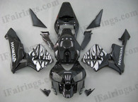Honda CBR600RR 2003 2004 black and silver flame fairing kits, this Honda CBR600RR 2003 2004 plastics was applied in black and silver flame graphics, this 2003 2004 CBR600RR fairing set comes with the both color and decals shown as the photo.If you want to do custom fairings for CBR600RR 2003 2004,our talented airbrusher will custom it for you