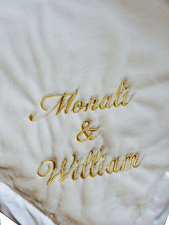 Little Giraffe Luxe Cream XL Throw Blanket shown with Golden Metallic Script Embroidery