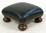Small Black Leather Ottoman with Bun Feet