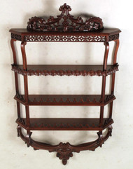 A George II Style Carved Mahogany Hanging Shelf