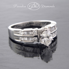 Style PDX521W Oval Center Diamond With Round And Baguettes Accent 14K White Gold