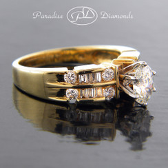 Style PDX521 - Classic Oval Diamond Engagement Ring with channel set round diamonds in 14K Yellow Gold