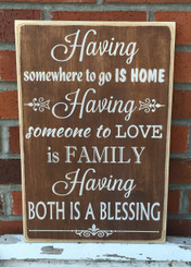 Having somewhere to go is home. Having someone to love is family. Having both is a blessing wood sign