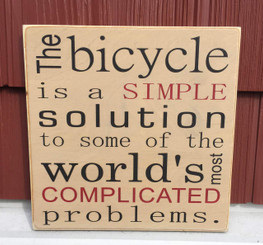 The bicycle is a simple solution to some of the world's most complicated problems. - wood sign