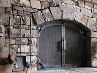 Hand forged fireplace doors by blacksmiths at Ponderosa Forge