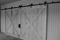 double wrought iron barn door tracks