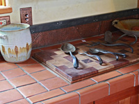 hand forged cookware, copper backsplash
