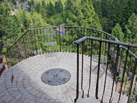 balcony deck railing with compass covered fire pit