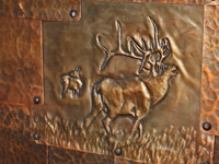 copper elk repousse in copper patchwork door