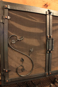 Hand forged fireplace door hinge option by blacksmiths at Ponderosa Forge