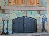 wrought iron fireplace doors with custom santa fe detail