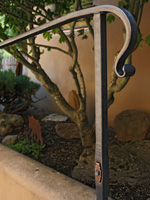 wrought iron grab railing with scroll detail