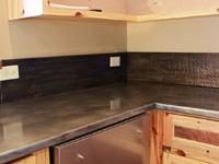 zinc countertop with hammered zinc backsplash