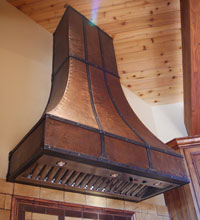 vaulted copper range hood