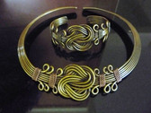 Brass choker and bracelet set.