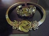 Brass choker and bracelet set.
