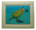 A framed tile with a painting of a green turtle in Barbados by Sue Trew