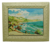 A framed tile with a painting of a Bathsheba in Barbados by Jill Walker