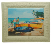 A framed tile with a painting of fishing boats in Barbados by Jill Walker