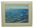 A framed tile with a painting of flying fish in Barbados by Holly Trew