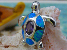 Turtle pendant made of sterling silver, amethyst and blue opal.