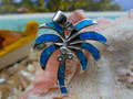 Palm pendant made of sterling silver and blue opal.