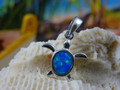 Turtle charm made of sterling silver and blue opal.