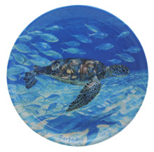 Small round dish with a turtle design.