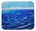 A mousepad with a painting of flyingfish skimming the Caribbean Sea by Holly Trew