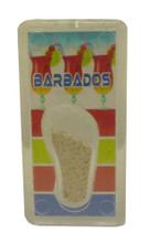 A magnet with an image of rum punch in Barbados and some Barbados sand.
