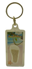 A keychain with an image of a beach in Barbados and some Barbados sand