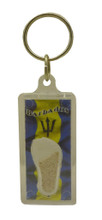 A keychain with he Barbados flag and Barbados sand.
