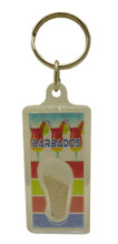 A keychain with real Barbados sand and rum punch images.