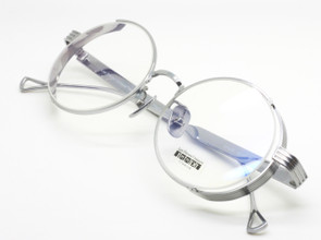 Almost round frames made in Japan