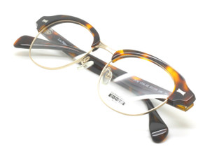 Acrylic and gold 60s frames from Les Pieces Uniques