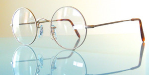 Handmade Savile Row eye glasses from The Old Glasses Shop