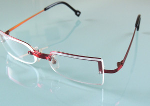 Red Metal Sara-Eliris Half Rim Style Designer Spectacles With Rimless Lenses