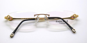 Front view of Faberge Rimless eyewear with diamante side details at www.theoldglassesshop.co.uk