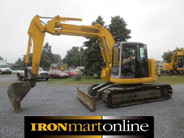 2001 Komatsu PC 128UU, in very good condition.