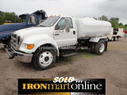 2006 Ford F-650 2,000 Gallon Water Truck, powered by CAT Diesel engine.