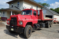 1985 R Model Mack Roll Off tandem-axle truck