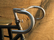 Nitto Grand Randonneur B132 Long ramps (flat section on top where the hands will go) on top with a 110 mm drop (to the bottom flat sections)