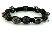 Black Crystal Beads and Black Gold Skull Bead Bracelet (Clear-Coated)