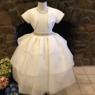 Christie Helene Jessica, Communion Dress, Couture Collection-From the Couture Collection. We are proud to feature Christie Helene's Couture Collection of custom communion dresses. Each dress is custom made to perfectly fit your child. The Couture Collection dresses are made with the finest materials including raw silk, taffeta, and/or bridal satin and embellished with embroidery, pearls, sequins and/or crystals. Please call us at 1.800.523.7604 for instructions on measuring your child and allow 8 to 10 weeks for delivery. Half sizes are available at an additional cost.