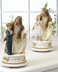 "Musical Jesus and Boy/Girl Child Figurines that play ""The Lord's Prayer"". Dimensions: 7.25""H x  3.75""W x 3.75""D. Gift Boxed"