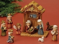 "11 Piece Nativity and Pageant Set.  8"" Stable. All pieces are made of a resin material.  Great for small children!"