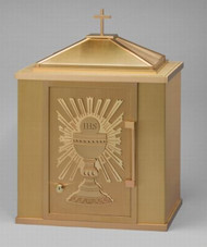 """7205 Tabernacle...shown with Eucharistic Sunburst Design- Dimensions of tabernacle are  25"""" tall including the cross, 18"""" width and 14"""" depth.  The single door opens from the left, door dimension is 9.5"""" wide x 15"""" tall.   Inside depth is 12"""".  Interior is lined with linen texture contact material.  Locking door.  Ability to fasten to the altar.  Brass construction with bronze lacquer coating. Alternate door designs available. Truck shipment required.  All door options are the same price. Custom door designs available on request."""