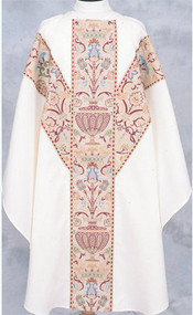 """Multi colored brocade with metallic gold accents expertly applied to a wrinkle free textured fortrel polyester. All edges of the brocade are trimmed with a half inch metallic gold galloon with coordinating burgundy accents. Plain Neckline or 3.5"""" Roll collar."""